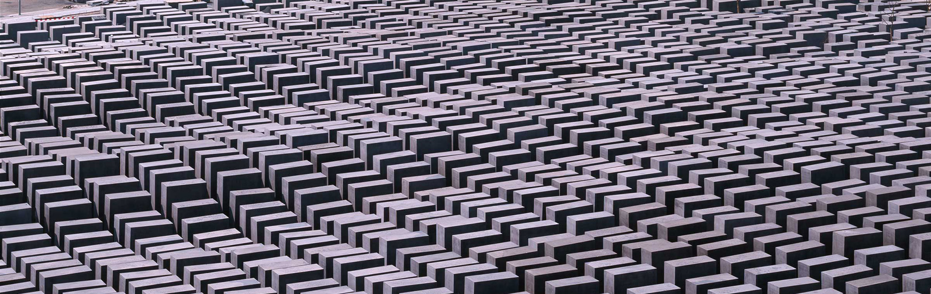 A field of undulating grey blocks extends beyond the frame in all directions