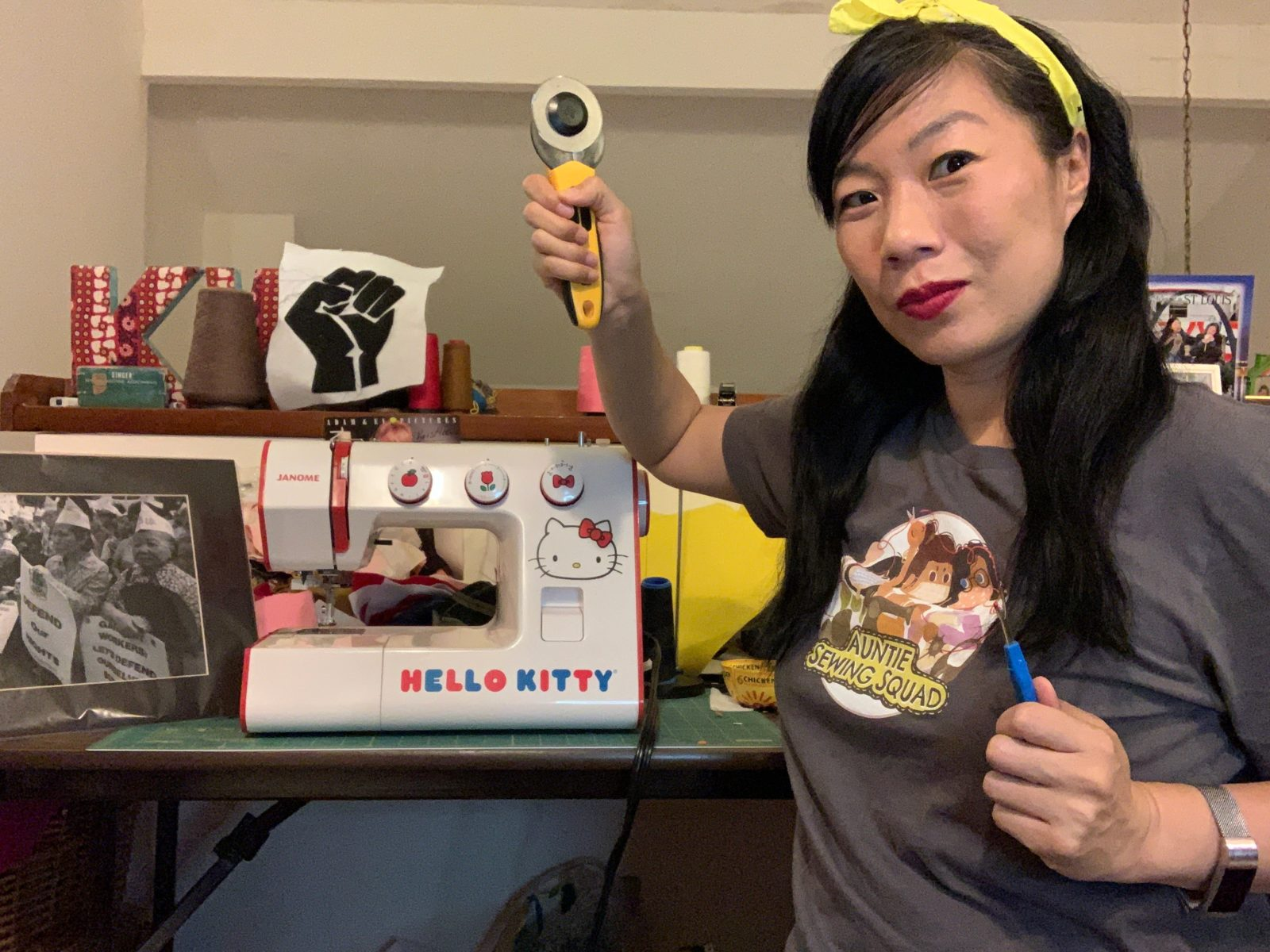 Artist Kristina Wong standing in front of Hello Kitty sewing machine.