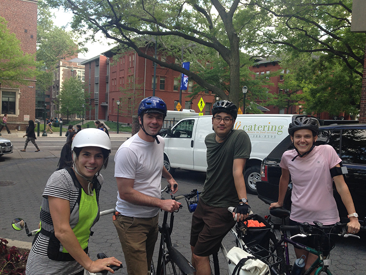 Group photo of several Penn professors with bikes