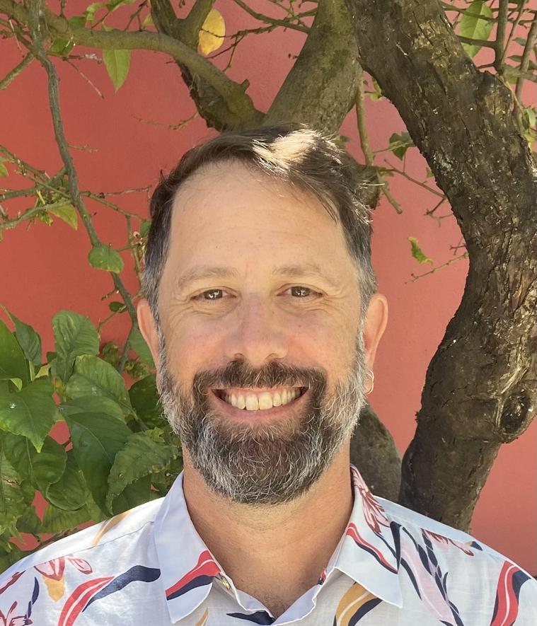 Prof. Barber smiling