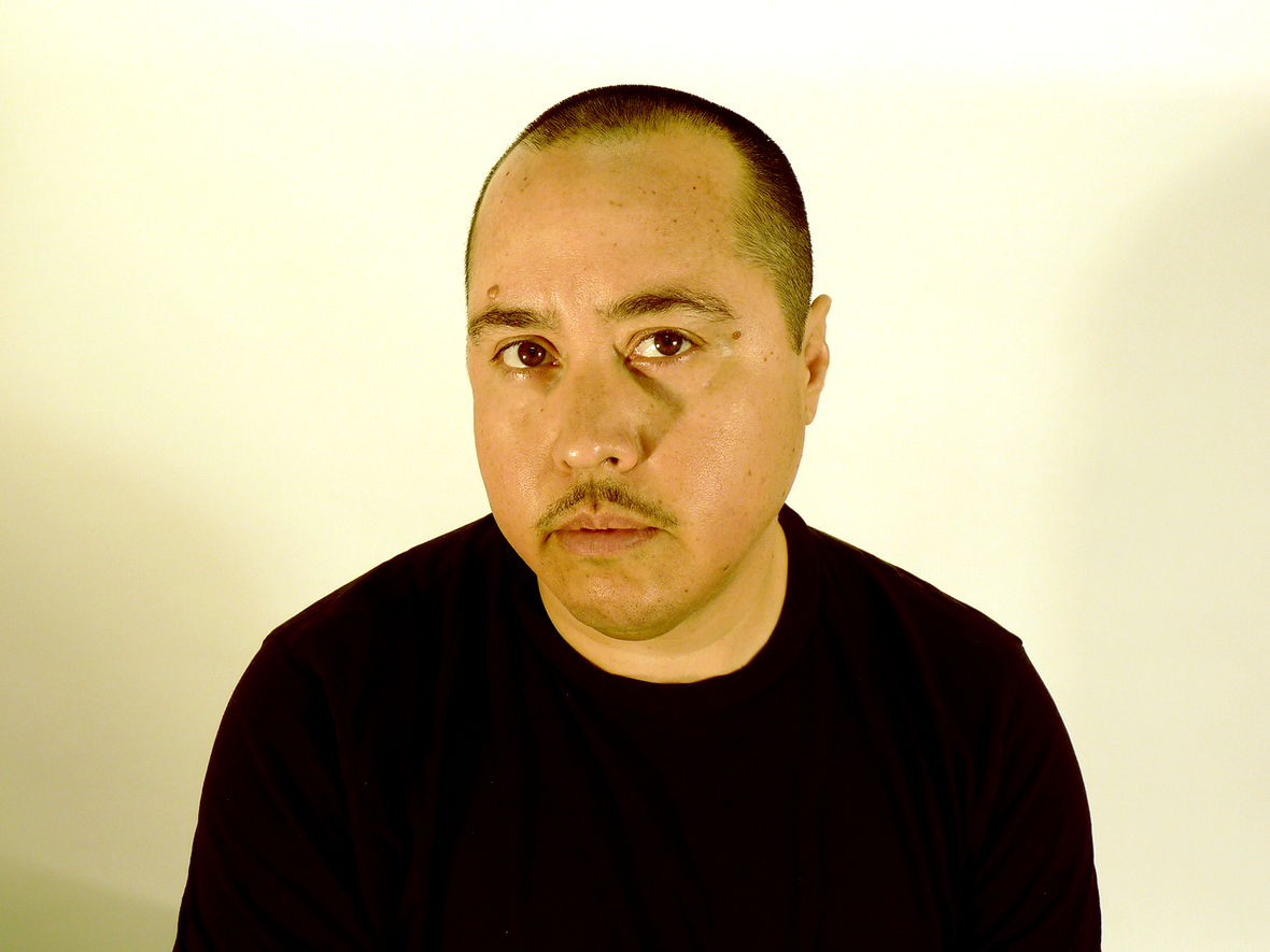 headshot of chris wearing a black shirt against a white background
