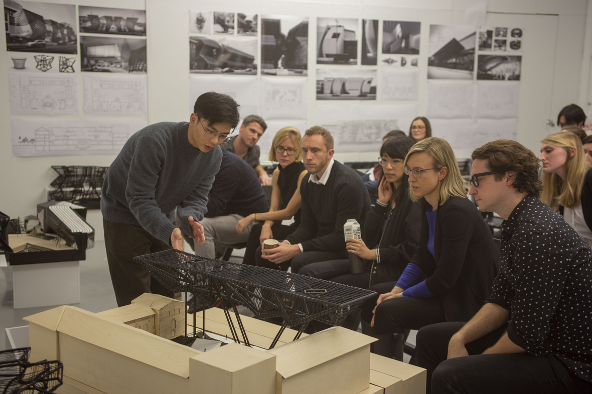 Student presents a model to a row of seated jurors