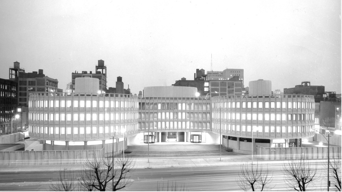 Black and White Photo of of concrete mid century 4 story building