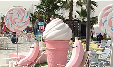 Oversized pink bananas and ice cream cone at outside a Dubai cafe