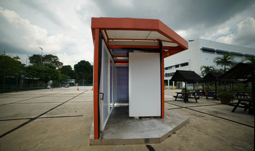 A radiant cooling pavilion with orange-painted steel frame and panelize walls in a site in Singapore