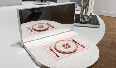 View of pink and white striped placemat and plate holding 4 round morsels