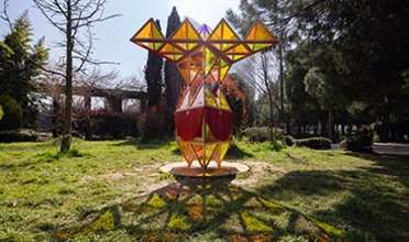 Brightly colored and angled structure in a park setting