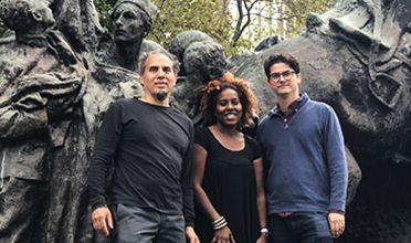 Paul Farber standing in front of sculpture with artist Manuel Acevedo and Salamishah Tillet