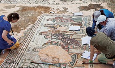 People working to preserve an ancient mosaic