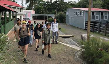 A group of students walking through a neighborhood in Puerto Rico
