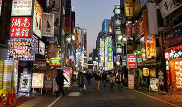 Night street scene of Shinjuku ward, Tokyo, Japan
