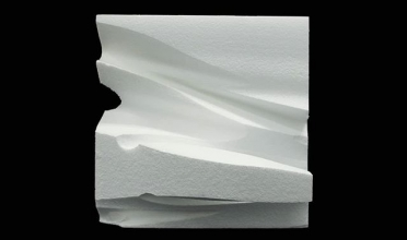 Abstract white block sculpture.