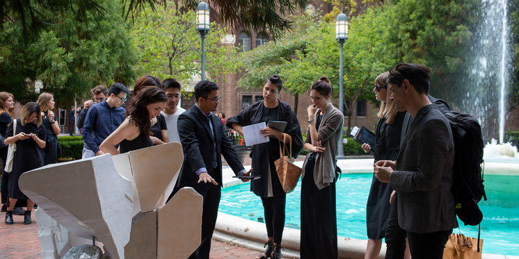Students gathered outside on campus for final reviews.