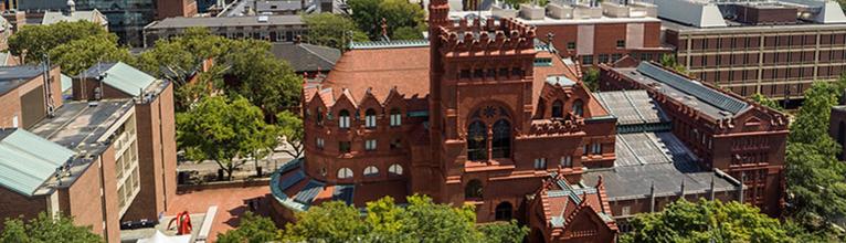 Brutalist brick building (Meyerson) next to ornate brick building (Fisher)