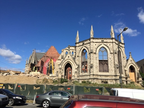 Partially destroyed church with fenced off region