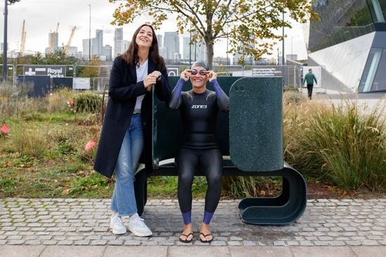 Alum Portia Malik poses next to her winning bench design