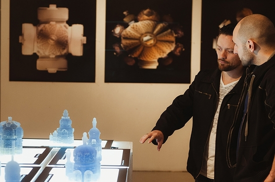 Two students looking at 3D printed models of Baroque buildings.