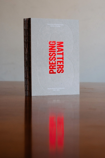 """Publication 'Pressing Matters 3"""" Stood on end on wooden table."""
