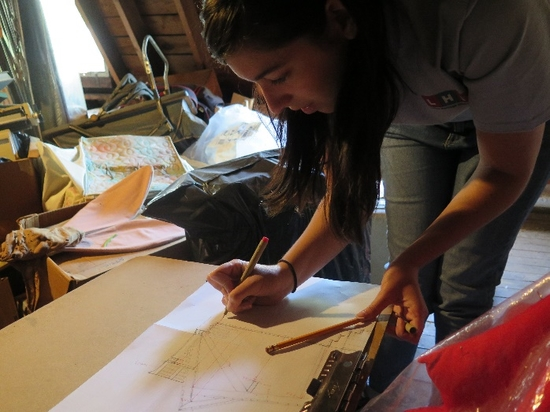 Student adding measurements to a field drawing.