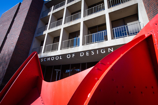 Close up of Calder sculpture with school of design building in the background
