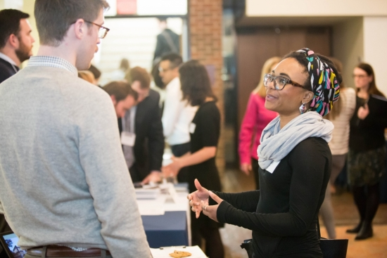 Two students chatting a career networking event.