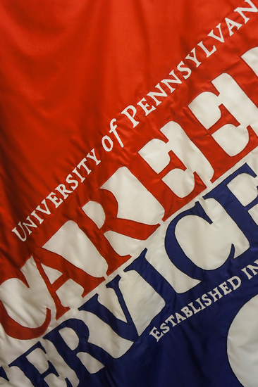 "Flag saying ""Upenn Career Services"""