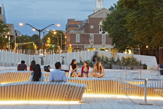 The plaza at Harvard with people using a large public seating area.