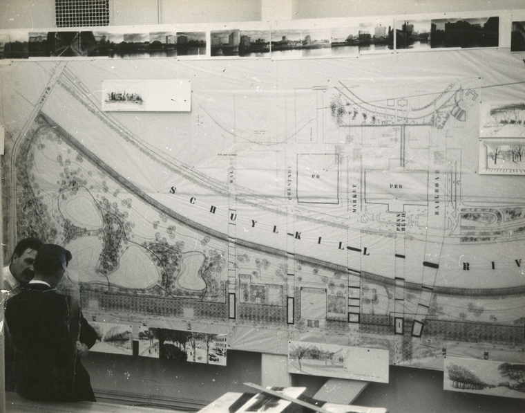 B/W photo of men standing next to blueprints of an area next to the Schuylkill