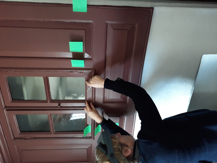 Person examining built in cabinetry