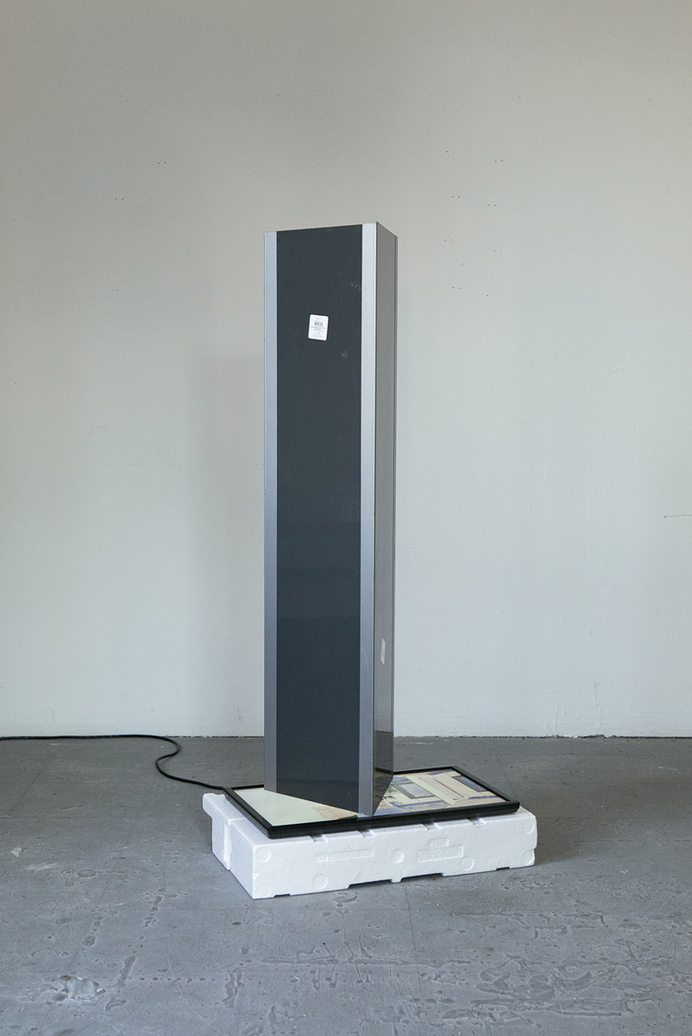 Tall thin sculpture with monitor built in