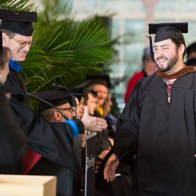 Sam Sklar facilitating graduation