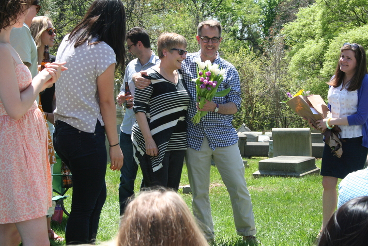 Randy Mason presents Suzanne Hyndman with flowers in honor of her retirement.