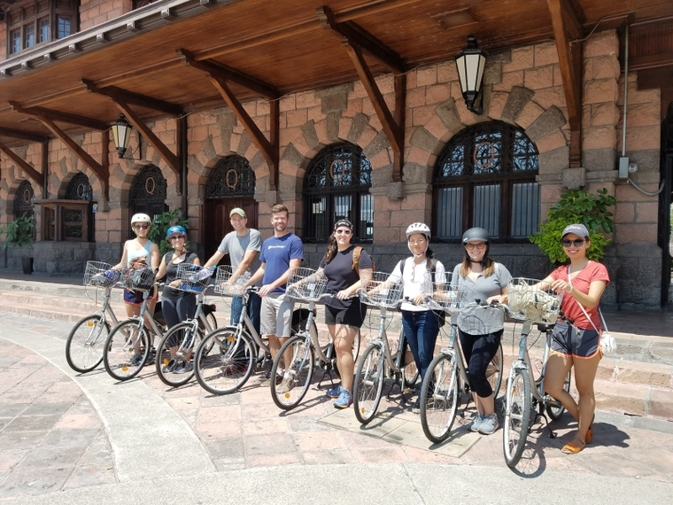 Group photo of cyclists with bikes