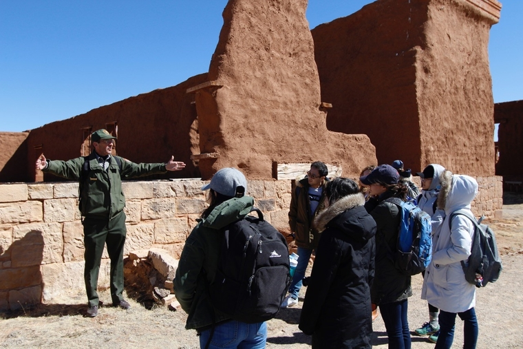 Students listen to an interpretive presentation by park staff in order to better understand the site's complex history.