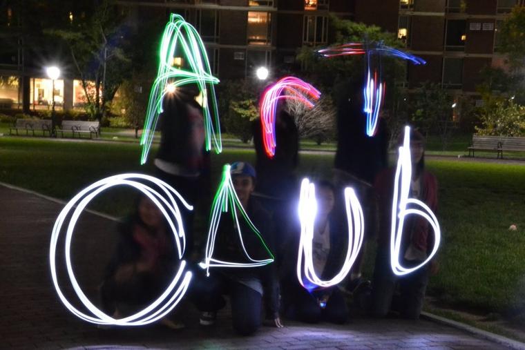 """Art Club"" written in moving light"