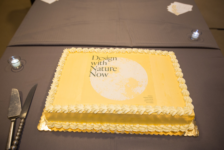 "Cake with ""Design With Nature Now"" logo on it"