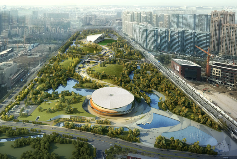 Aerial view of round stadium in a landscape of trees