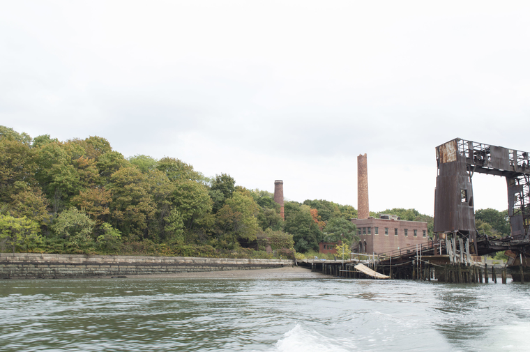 The gantry and beach provided an access point to North Brother Island. The smokestacks are the most visible built fabric from the Bronx shore. Photo by Andrea Haley.