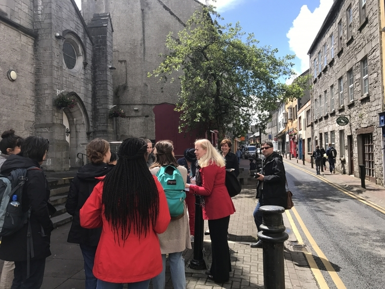 Group gathers on street in Galway