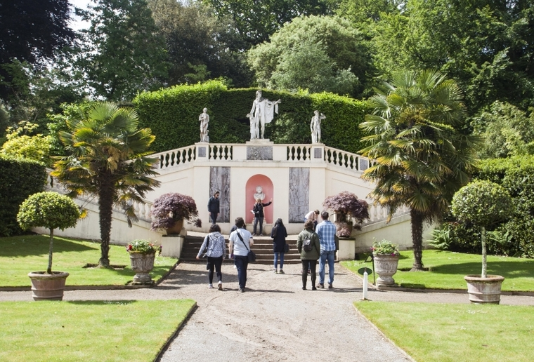 The group examines statuary in the Italian garden while comparing Formal and English style landscapes at Mount Edgcumbe. Photo: Starr Herr-Cardillo.