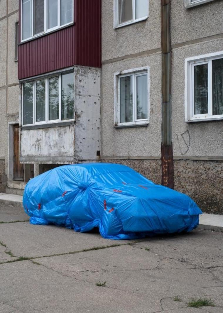 Car wrapped in tarp