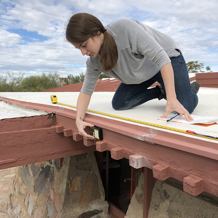 Mia Maloney conducts an assessment on the wooden features of the Original Dining Room at Taliesin West in January of 2019. In order to understand the degree of deterioration of the four projecting beams, moisture content readings are recorded and mapped on elevation drawings.