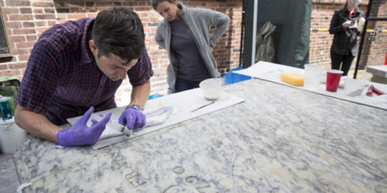Using a syringe filled with a breathable, lime-based injection grout, Federico and his team filled the voids of Franklin's marble grave marker.