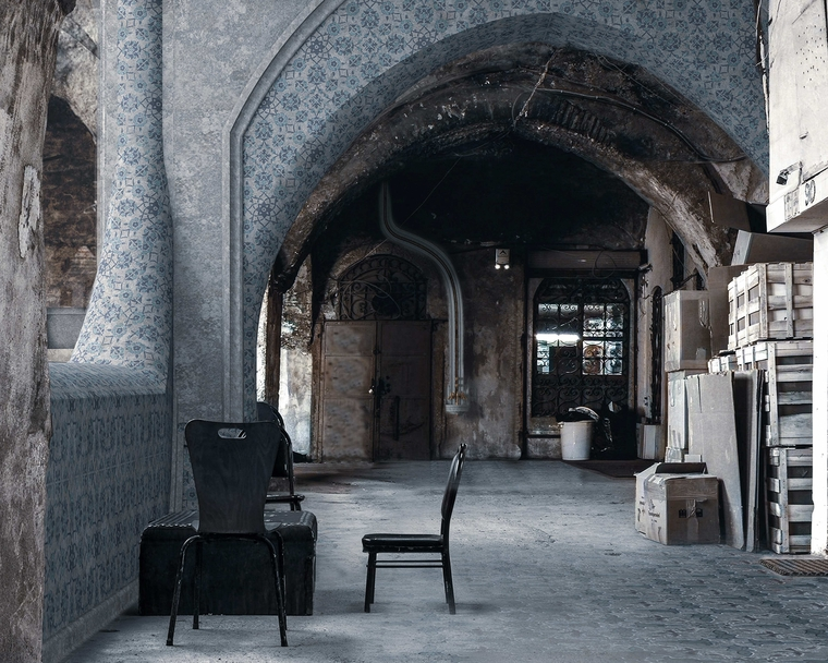 Architectural render of interior arched space with crates stacked to the right and a semicircle of mismatched chairs to the left
