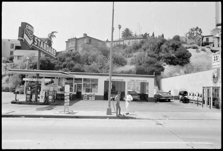 Black and white photo of Standard gas station