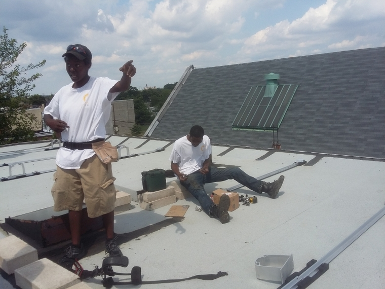 Apprentices Ky and Robert learning about solar installation.