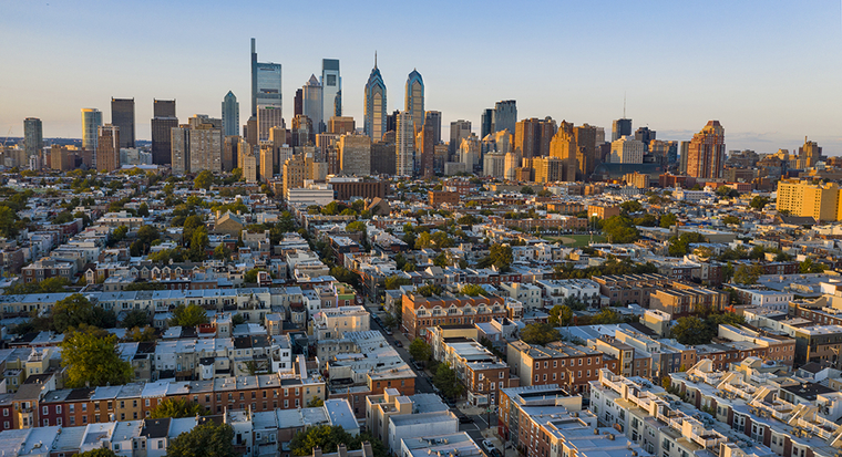Aerial photo showing the street grid of Philadelphia with skyline in the distance