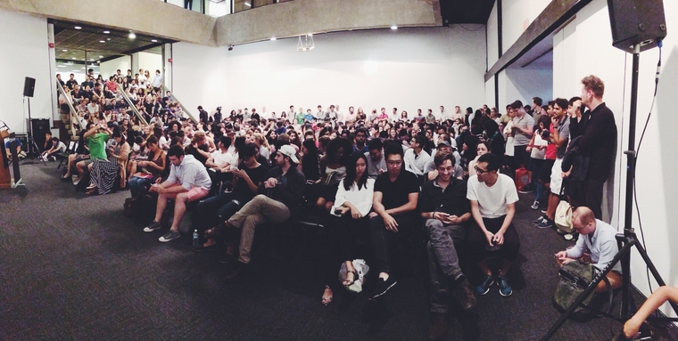 Large group listening to a lecture