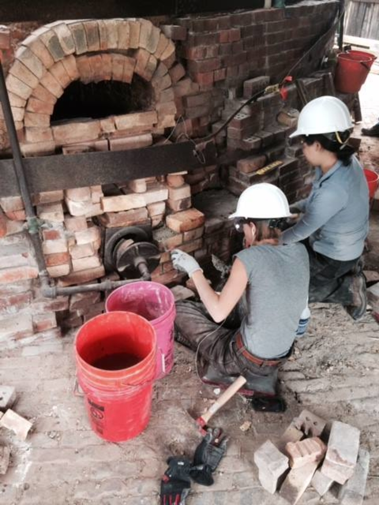 Casey Weisdock (left) and Jean Jang (right) have been putting in many hours with trowel in hand in the effort to stop deterioration at Kilns 7 and 8.