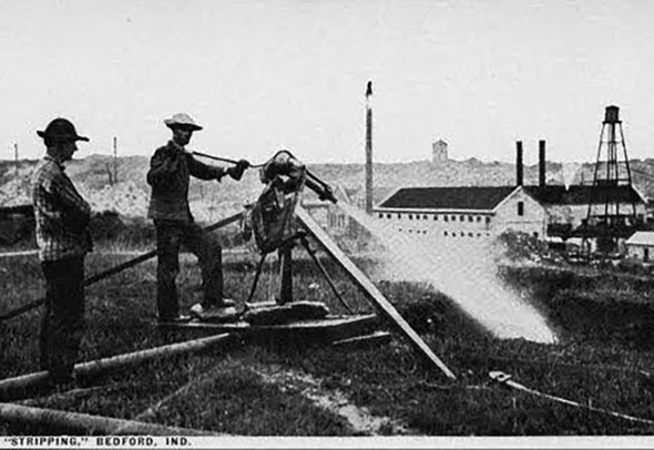 Historic photo of a man power washing a stone